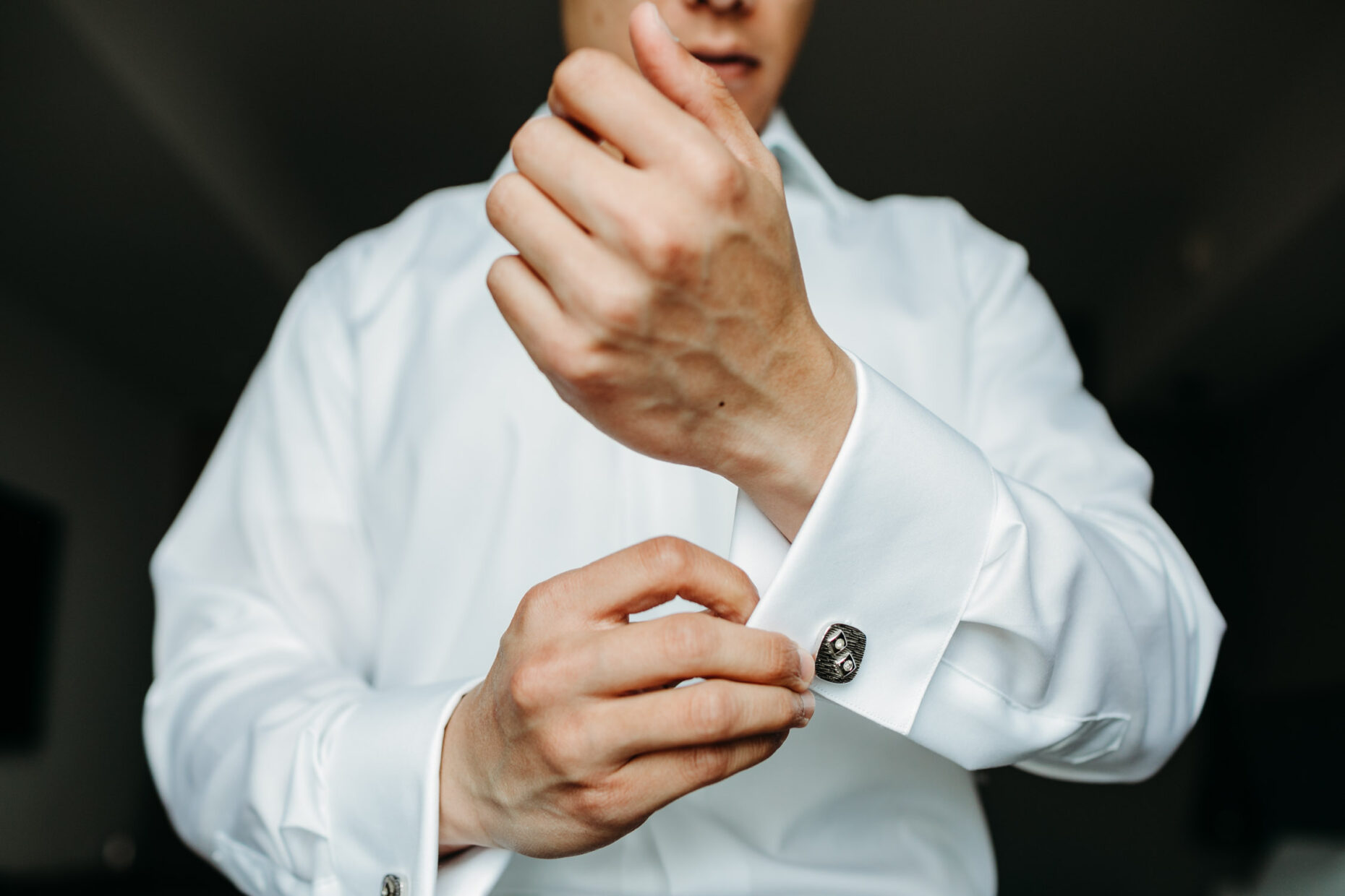 detail close up of groom getting ready