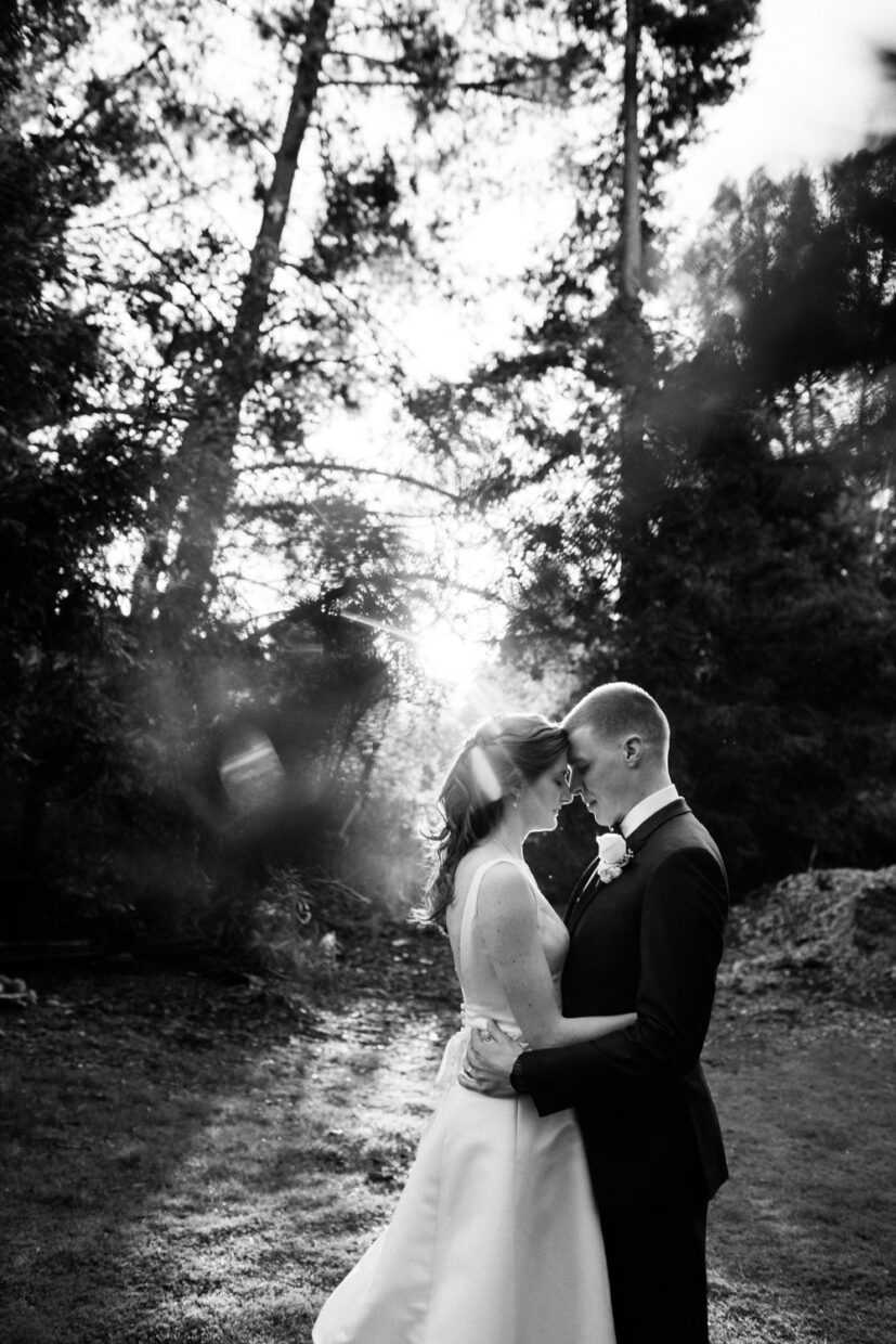 Black and white image of bride and groom intimate moment with beautiful light in Carmel california
