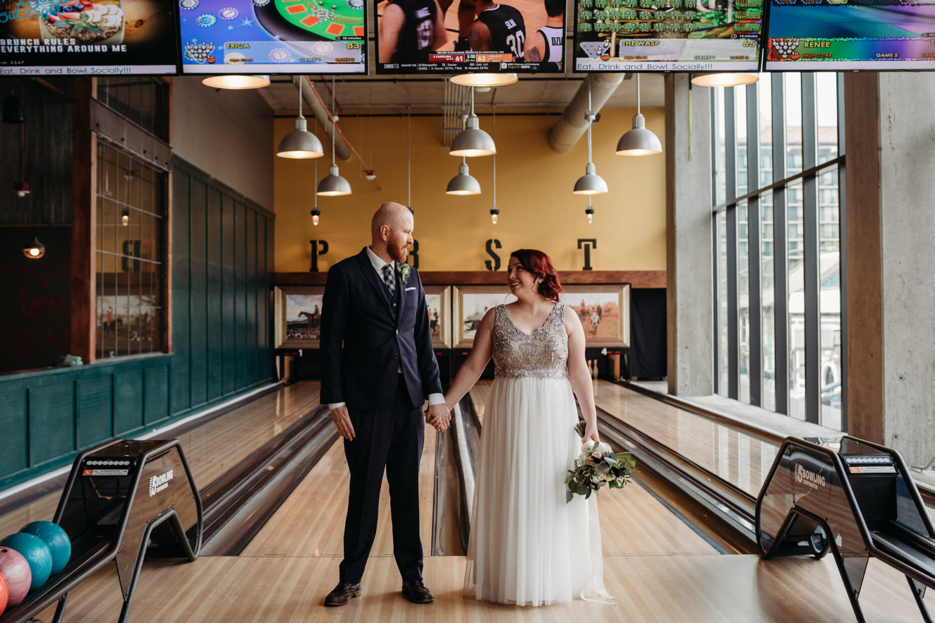 Bride and groom at the bowling alley. Punch bowl Sacramento California