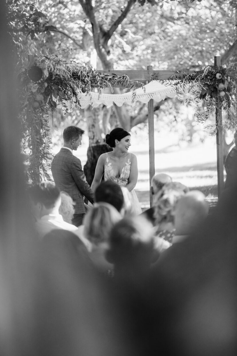 sweet intimate moment of bride and groom at their wedding ceremony in an orchard farm at full belly farm