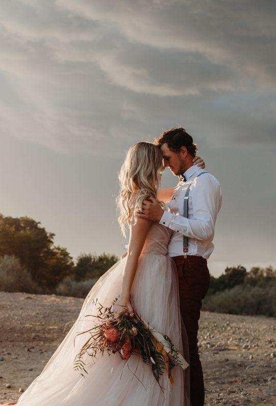 beautiful dramatic photo of boho couple with Fall vibes