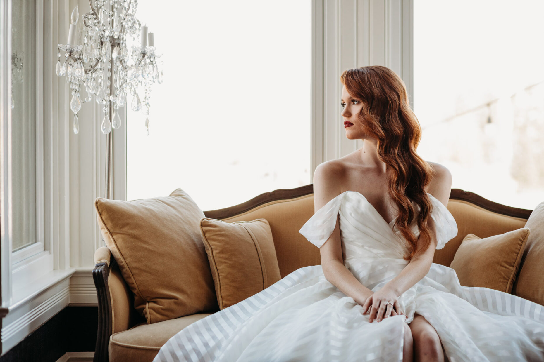 bride looking out the window at park victorian wedding venue in auburn
