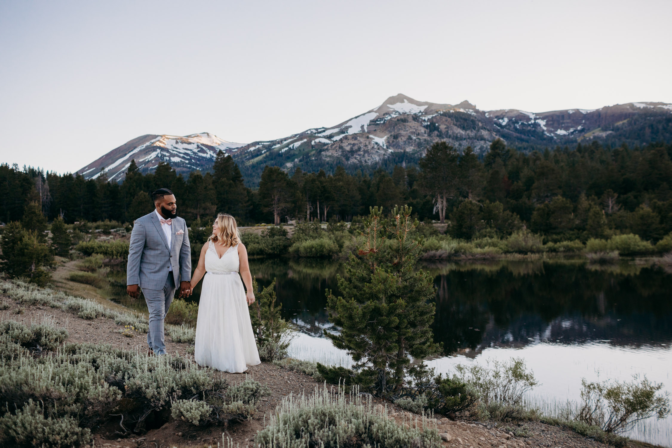 tahoe elopement at hope valley bride and groom walking by the lake
